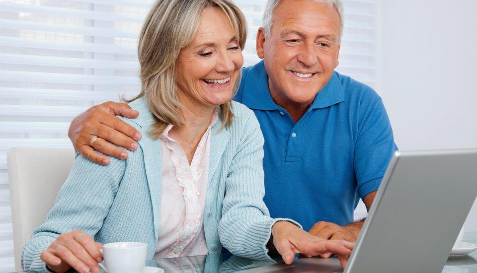 man-woman-browsing-internet-on-laptop