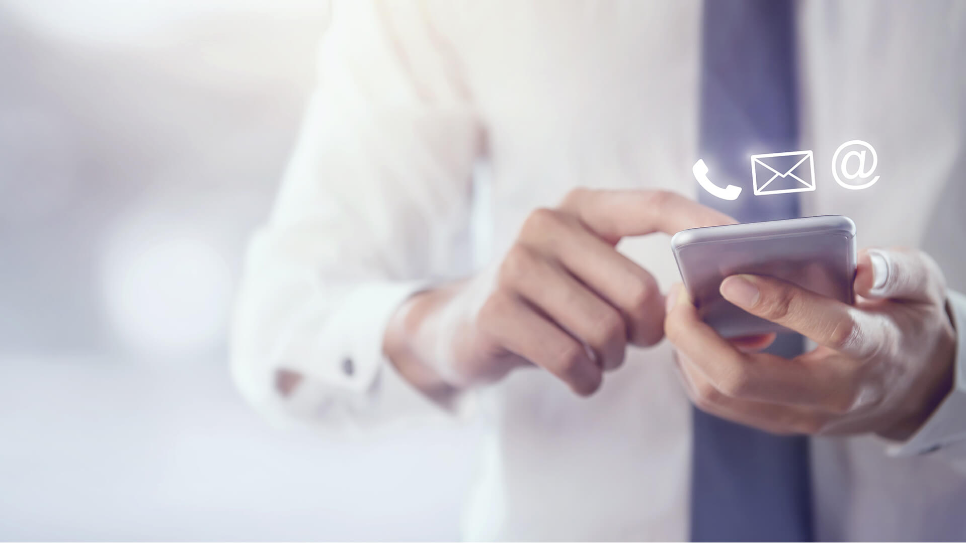 Man using a phone and phone and email icons